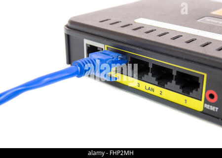 Close up LAN UTP RJ45 Cat5e connect to ADSL Router network switch - Stock Photo