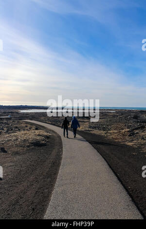 people walking in Iceland - Stock Photo