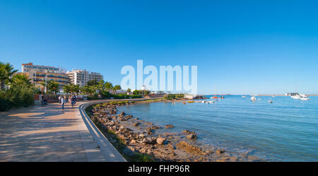Mid morning sun on the waterfront.  Warm sunny day along the beach in Ibiza, St Antoni de Portmany Balearic Islands, - Stock Photo