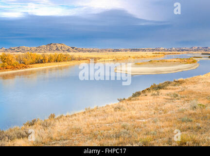 yellowstone river flowing past badlands in autumn near terry, montana - Stock Photo