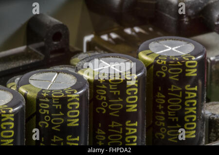 Close up of an array of Electrolytic Capacitors on a Printed Circuit Board (PCB) - Stock Photo