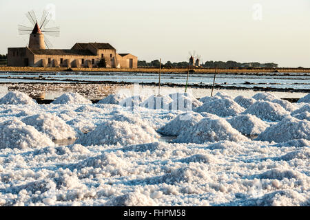 Pans of Trapani with windmills, in Sicily - Stock Photo