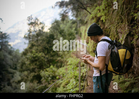 Portugal, Madeira, man on hiking trip along the Levadas - Stock Photo
