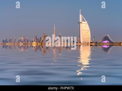 Skyline of Dubai waterfront with Burj al Arab Hotel in United Arab Emirates - Stock Photo