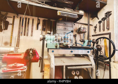 Home maintenance - An untidy workbench full of dusty old ...