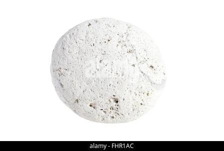 Round porous light weight pumice stone showing holes isolated on white background - Stock Photo
