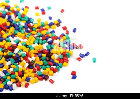 Colourful plastic granules isolated on a white background - Stock Photo