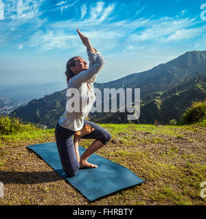 Young woman doing yoga advanced asana - Stock Photo