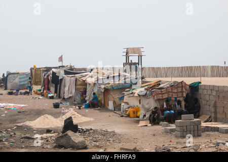 ACCRA, GHANA - JANUARY 2016: Slums on the beach in Accra, Ghana at the Gulf of Guinea - Stock Photo