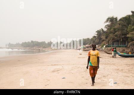 ACCRA, GHANA - JANUARY 2016: Fishermen with boats on the beach in Krokobite in Accra, Ghana - Stock Photo