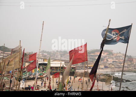 Pirate flag of one of the fishing boats in Cape Coast in Ghana - Stock Photo