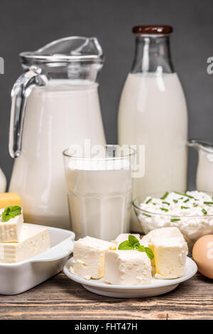Fresh dairy products on an old wooden board - Stock Photo