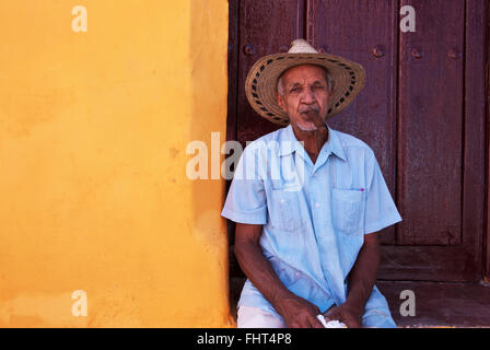 Older man with Cigar in mouth, town Cmagüey, Cuba - Stock Photo