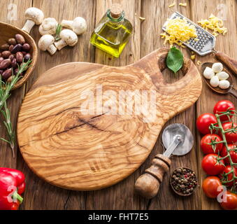 Pizza ingredients: mushrooms, olives, cheese and tomatoes. - Stock Photo