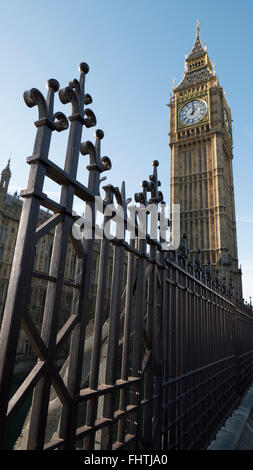The fence in front of Big Ben and the Houses Of Parliament in London. - Stock Photo