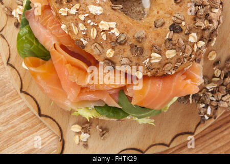 Culinary bagel eating. - Stock Photo