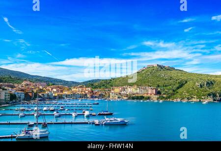 Porto Ercole village and boatd in harbor in a sea bay. Filippo fort on background. Aerial view. Monte Argentario, - Stock Photo