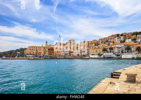 Porto Santo Stefano harbor seafront, bolllard and village skyline., italian travel destination. Monte Argentario, - Stock Photo