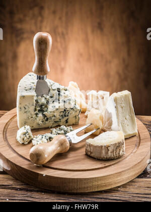 Danish blue cheese on a wooden board. - Stock Photo