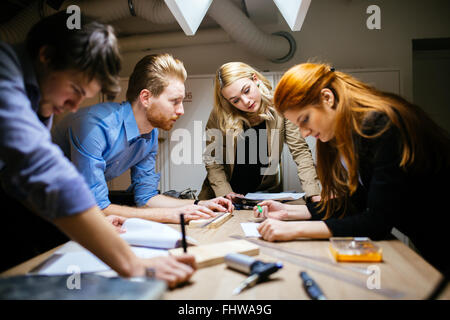 Group of creative designers brainstorming and working on a project - Stock Photo