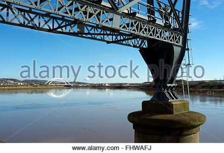 The River Usk in Newport, with part of the Transporter Bridge in foreground, and the City Bridge in distance. Newport, - Stock Photo