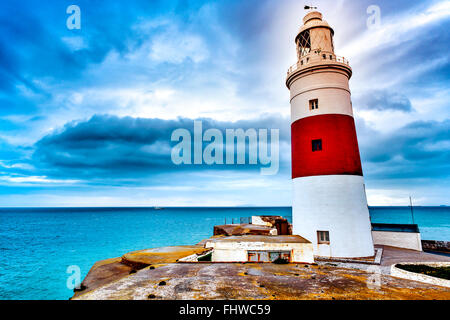 a view of the Trinity Lighthouse at Europa Point, in Gibraltar, and the Mediterranean sea in a cloudy day - Stock Photo
