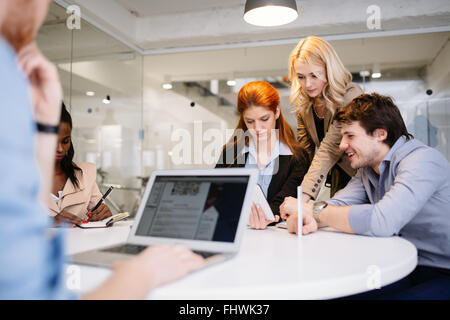 Businesspeople working in office and sharing ideas - Stock Photo