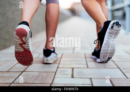 Jogging athletic women - closeup on legs - Stock Photo