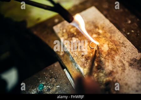 Creation of a ring the traditional way - Stock Photo