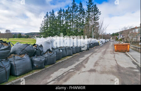 BALLATER  ABERDEENSHIRE RIVER DEE FLOOD DAMAGE  ROAD BESIDE THE GOLF COURSE LINED WITH LARGE SAND FILLED BAGS - Stock Photo