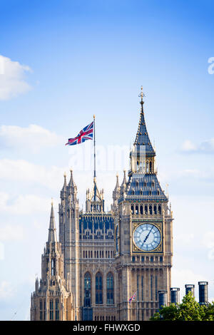 London - Big Ben and the Houses of Parliament (Palace of Westminster) with the Union Jack UK national flag flying - Stock Photo
