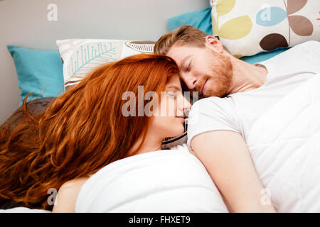 Beautiful couple in love sleeping - Stock Photo