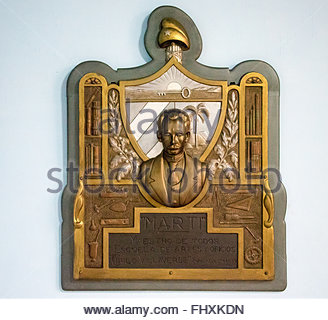 Jose Marti and the Cuban coat of armas haging on a wall. Jose Marti is the National Hero due to its writings and - Stock Photo