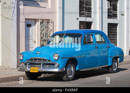 old Plymouth blue car parked in street at Cienfuegos, Cuba, West Indies, Caribbean, Central America - Stock Photo