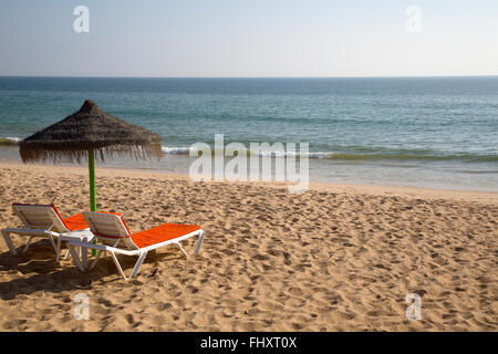 Sunbeds on a Beach in the Algarve, Portugal - Stock Photo