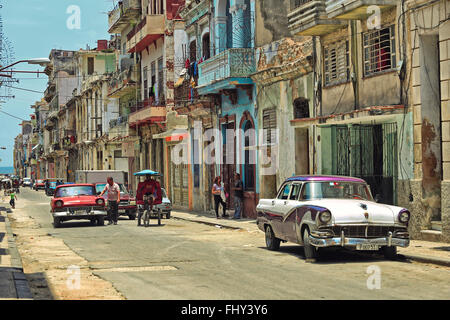 Vintage American car on the background of the old colonial buildings of Old Havana. Vintage style photo - Stock Photo