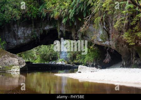 Moria Gate Arch, Oparara river, near Karamea, Westcoast, New Zealand - Stock Photo