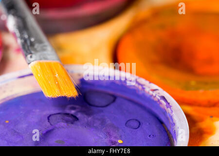 Paintbrush Close Up with water colour palette - Stock Photo