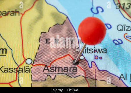 Close-up of a red pushpin in a map of Asmara (or Asmera), Eritrea. - Stock Photo