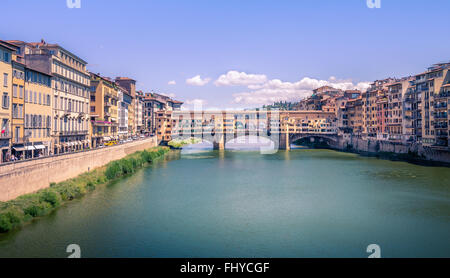 Famous bridge Ponte Vecchio and Arno river in Florence, Italy - Stock Photo