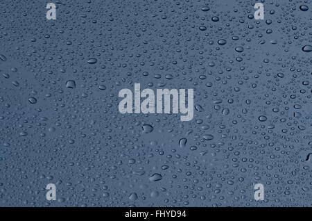 Drops on glass, a grey-blue background - Stock Photo