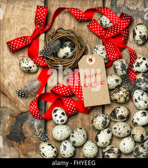 Easter decoration eggs with red ribbon bow and tag. Happy Easter - Stock Photo