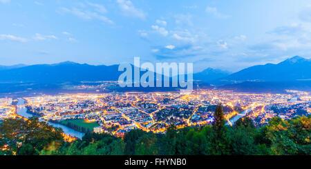 Austria, Tyrol, Innsbruck, Cityscape, blue hour - Stock Photo