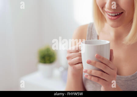 Having a wonderful cup of hot coffee - Stock Photo
