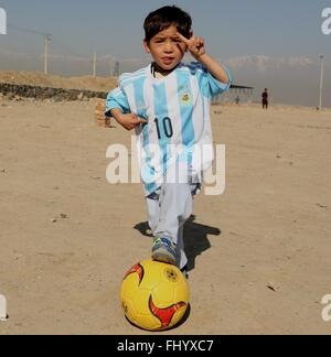 Kabul, Afghanistan. 26th Feb, 2016. Afghan boy Murtaza Ahmadi poses for photos wearing a new jersey signed by Argentina - Stock Photo