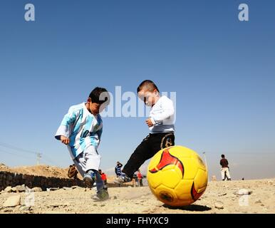 Kabul, Afghanistan. 26th Feb, 2016. Afghan boy Murtaza Ahmadi wearing a new jersey signed by Argentina soccer star - Stock Photo