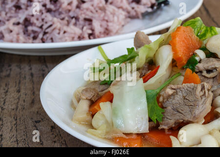 fried pork with mixed vegetables and cooked rice - Stock Photo