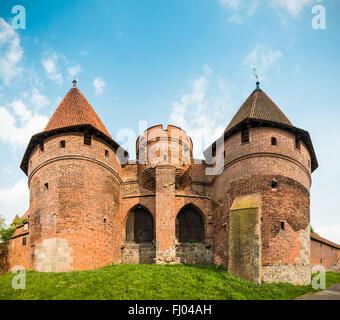 Teutonic Castle in Malbork (Marienburg) in Pomerania, Poland, Europe. UNESCO world heritage site. Blue sky with - Stock Photo
