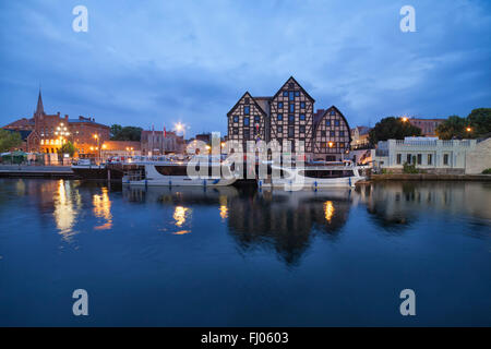 Poland, Bydgoszcz, cityscape in the evening with old granaries - Stock Photo