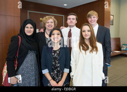 High school students serving as prosecuting attorneys in mock trial pose with teacher outside courtroom in San Marcos - Stock Photo